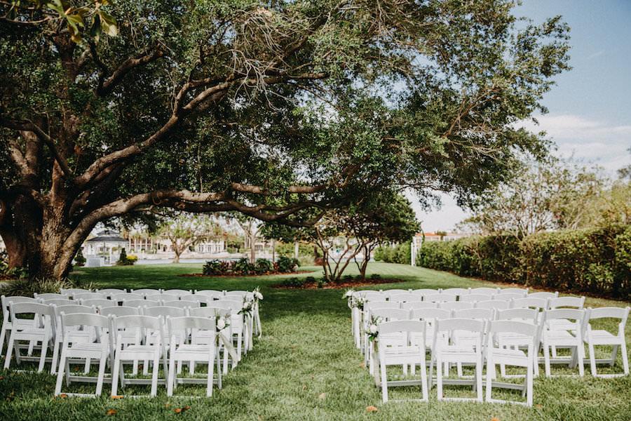 Outdoor Wedding Ceremony with White Folding Chairs   Waterfront Tampa Bay Wedding Venue Davis Islands Garden Club
