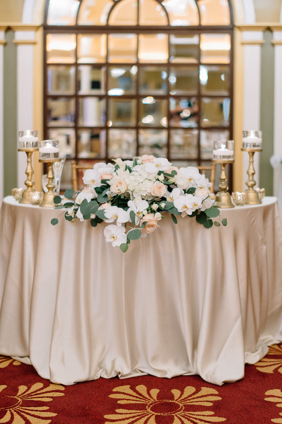 Elegant and Romantic Gold Blush and Ivory Wedding Reception Table Decor with Rose and Greenery Centerpiece and Tall Gold Candle Holders and Blush Linen