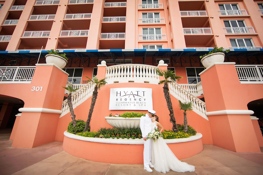 Outdoor Bride and Groom Portrait for Navy Military Wedding with White Floral and Greenery Bouquet | Wedding Hotel Venue Hyatt Regency Clearwater Resort | Tampa Bay Photographer Limelight Photography