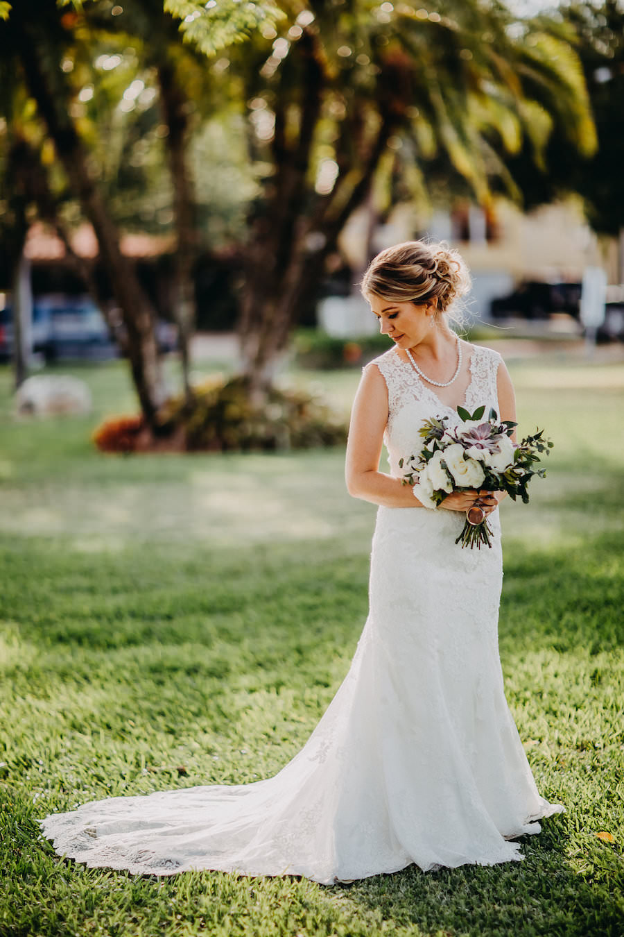 Bride Wedding Garden Portrait Wearing Maggie Sottero Lace Wedding Dress with White and Purple Bouquet with Greenery   Tampa Bay Wedding Photographer Rad Red Creative