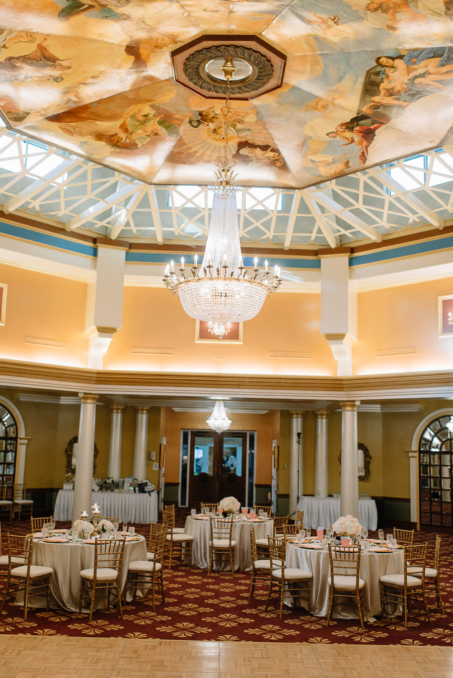 Gold Ivory and Blush Ballroom Wedding Reception Decor at Tampa Bay Wedding Venue Safety Harbor Resort & Spa with Gold Chiavari Chairs, Low White Floral Centerpieces | Tampa Bay Wedding Planner Special Moments Event Planning | Signature Event Rentals