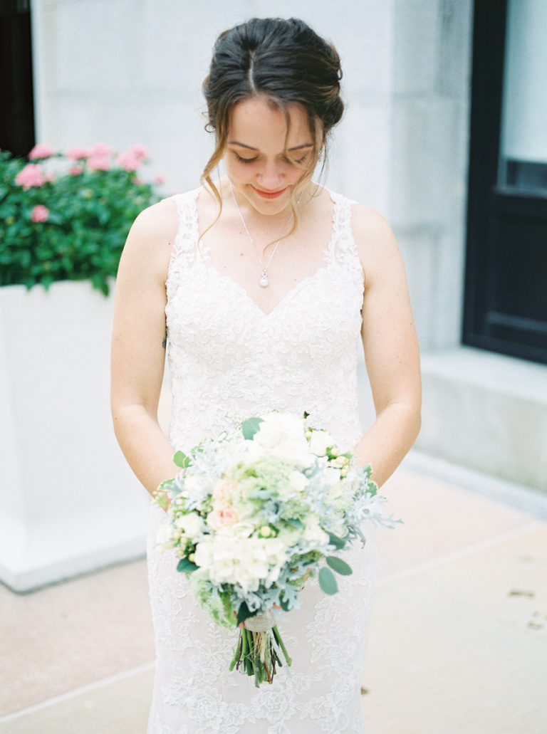 Outdoor Bridal Portrait with White Pink and Blue Bouquet with Greenery Wearing White Lace Trumpet Wedding Dress