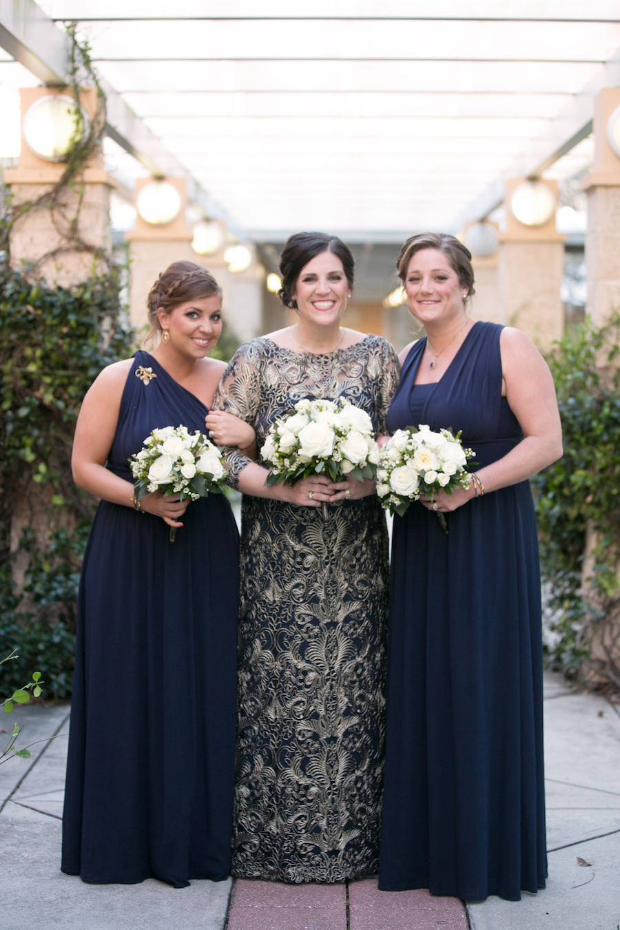 Outdoor Garden Bridal Portrait wearing Embroidered Navy Vintage Inspired Lace Wedding Dress by Tadashi Shoji with White Rose Bouquet by Northside Florist and White House Black Market Navy Blue Mismatched Bridesmaids Dresses   Tampa Bay Photographer Carrie Wildes Photography