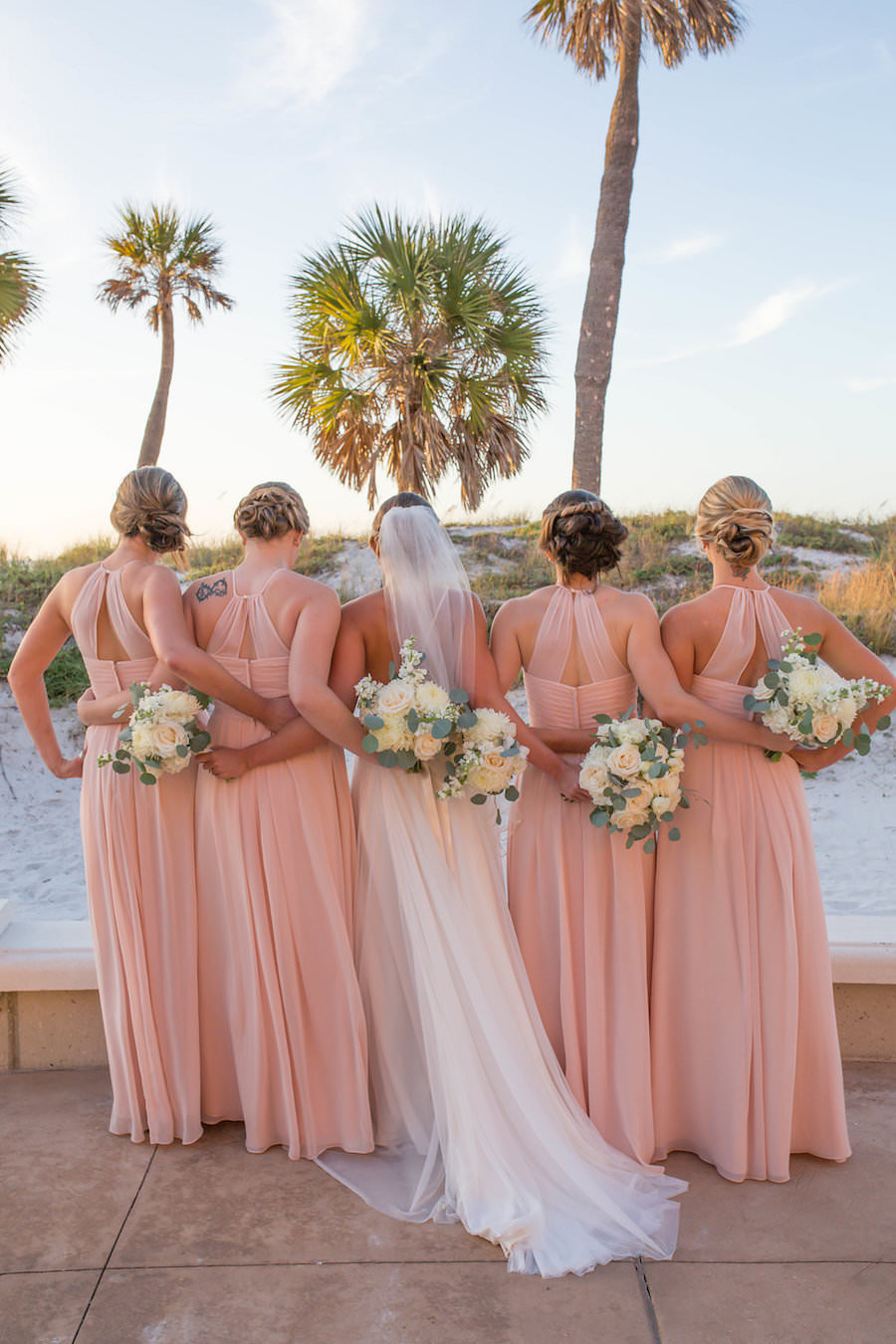 4b68c05afbcc76 Outdoor Beach Bridal Party Portrait with Blush Azazie Bridesmaids Dresses  White Bouquets with Greenery | Clearwater Beach Wedding