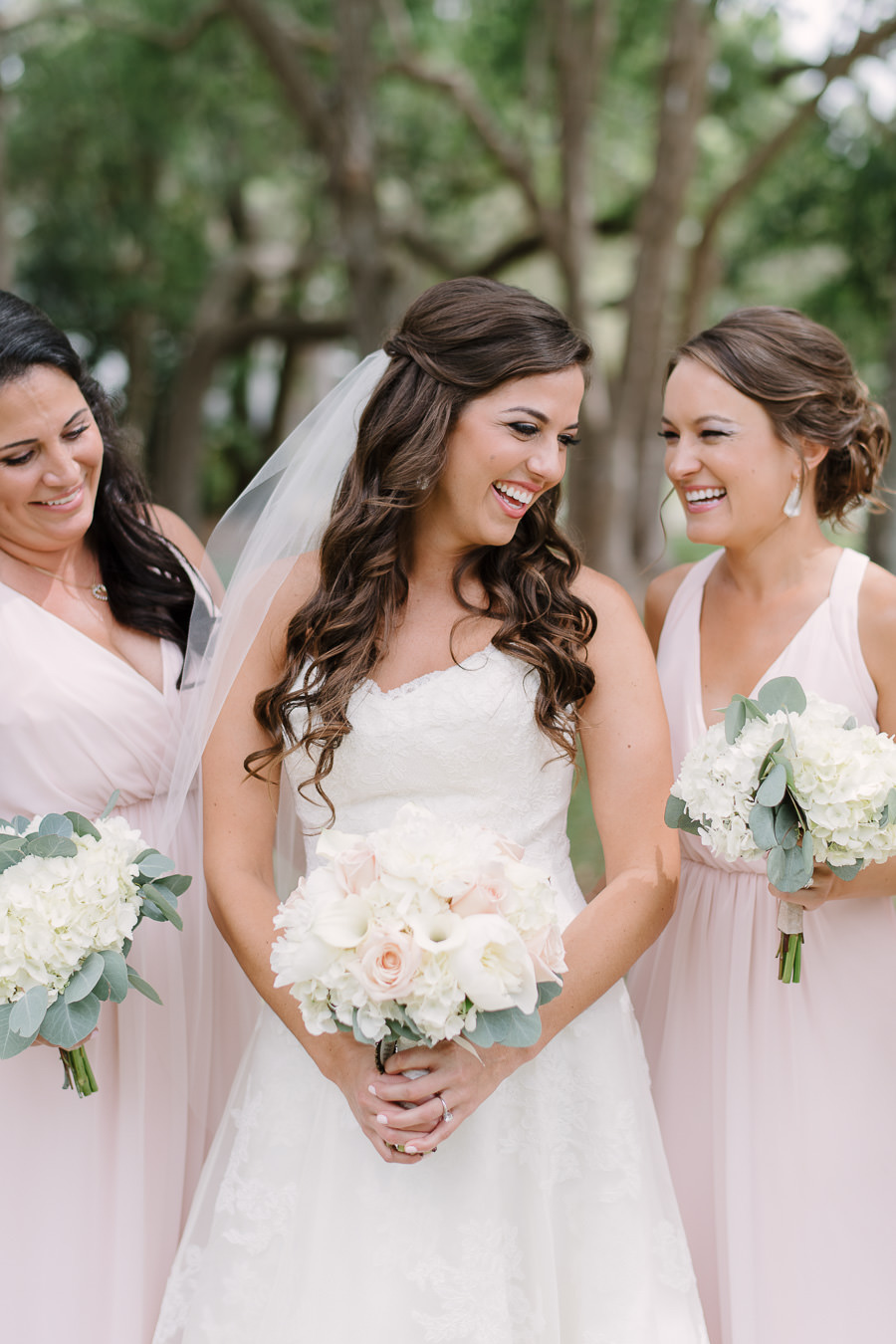 Outdoor Portrait of Bride in Watters Wedding Dress with Rose and Hydrangea Bouquet with Greenery and Blush Pink Mismatched Hayley Paige Bridesmaids Dresses