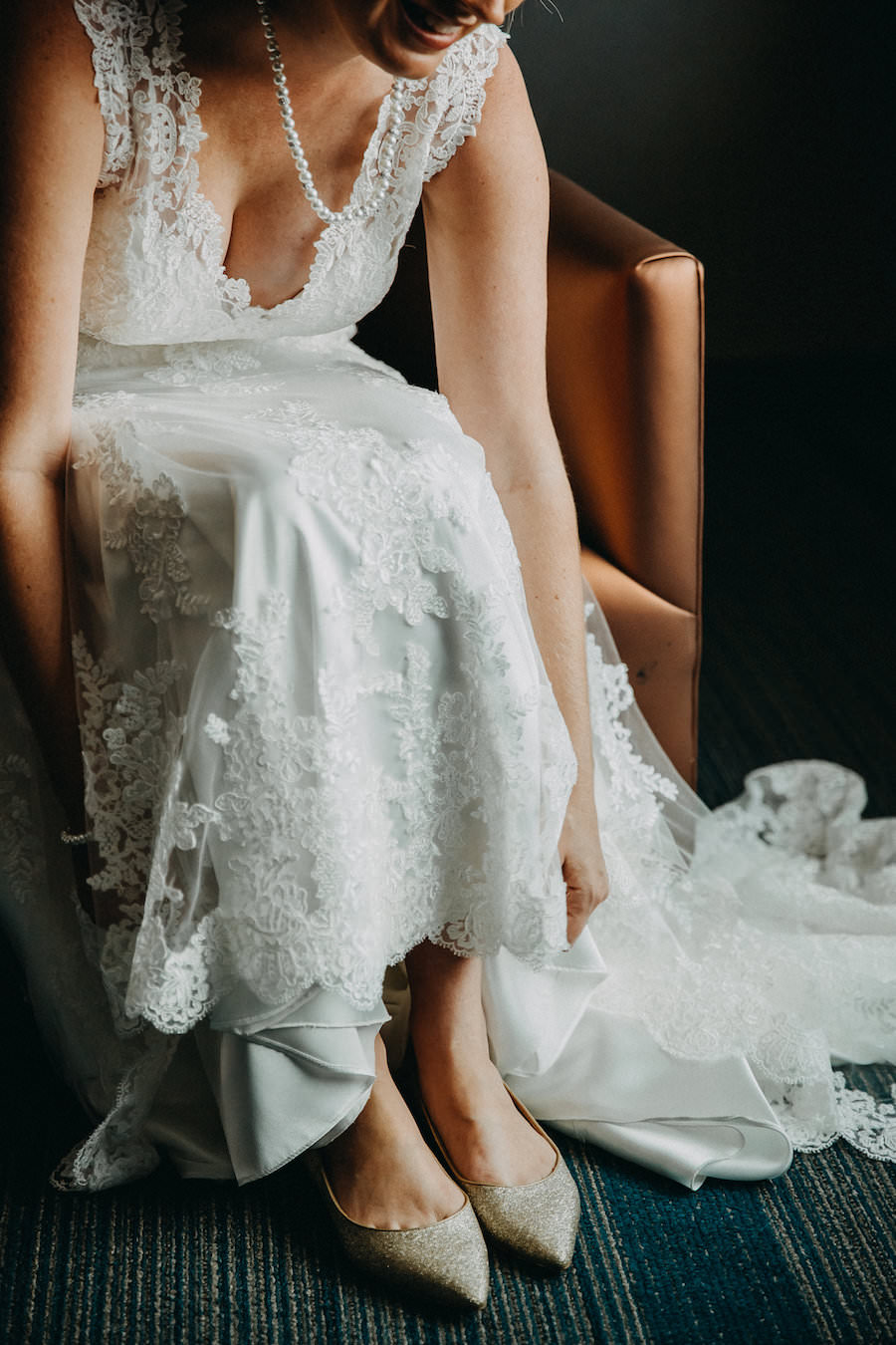 Bride Getting Ready Portrait on Wedding Day Putting On Gold Glitter Sam Edelman Shoes Wearing Lace Maggie Sottero Dress   Tampa Bay Wedding Photographer Rad Red Creative