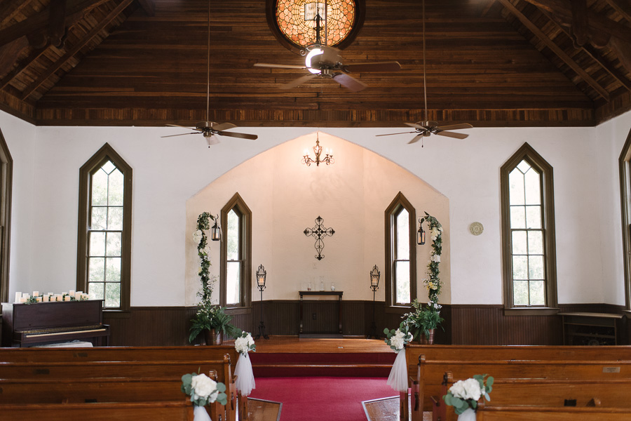 White Floral Aisle Decor with Tulle and Tall Lamp Post with Greenery | Tampa Bay Wedding Venue Church Andrews Memorial Chapel Dunedin Florida