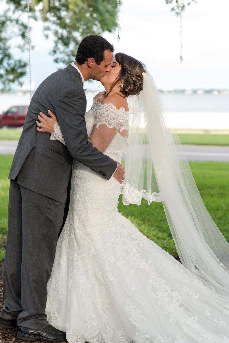 Outdoor Waterfront Garden Wedding Ceremony Portrait with Allure Wedding Dress   South Tampa Wedding Photographer Caroline & Evan Photography
