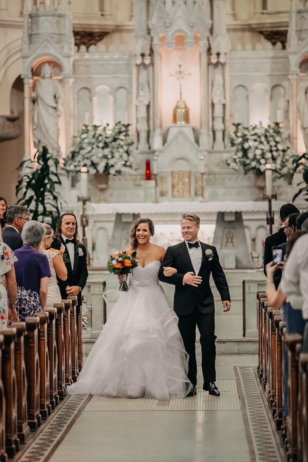 Traditional Church Wedding Ceremony Bride and Groom Exit Portrait with Orange and Greenery Tropical Bouquet   Tampa Bay Wedding Photographer Rad Red Creative