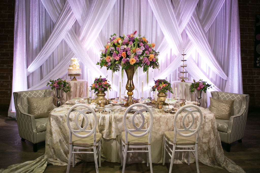 Modern Wedding Reception With Unique Vintage Inspired Furniture And Linens,  Tropical Orange, Pink, And Purple Rose With Greenery Centerpieces In Tall  Gold ...