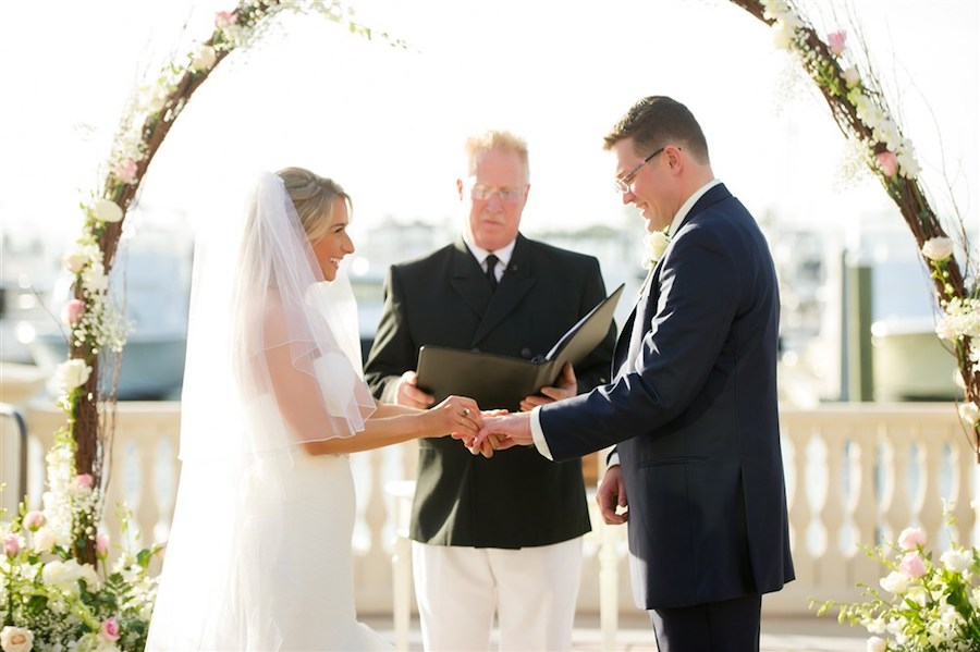 Outdoor Waterfront Wedding Ceremony with White and Pink Natural Branch Arch   Tampa Bay Wedding Venue Westshore Yacht Club   Photographer Andi Diamond Photography