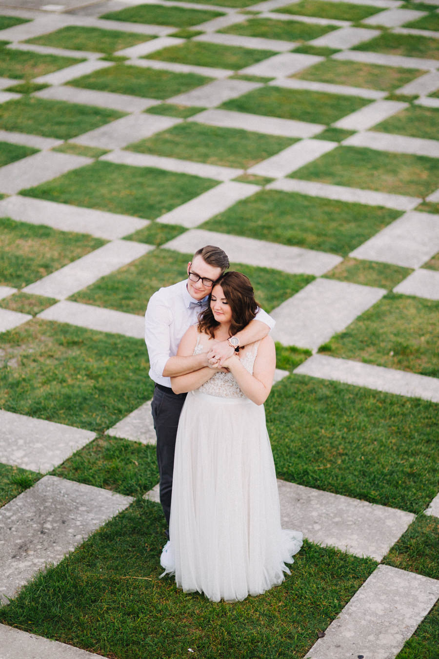Downtown Tampa Outdoor Wedding Portrait with Groom in White Shirt with Gray Bowtie, Bride in A Line Watters Wedding Dress