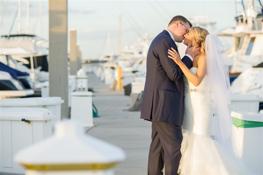 Outdoor Waterfront Wedding Ceremony with White Mermaid Sweetheart Belted Dress at Tampa Bay Wedding Venue Westshore Yacht Club   Photographer Andi Diamond Photography