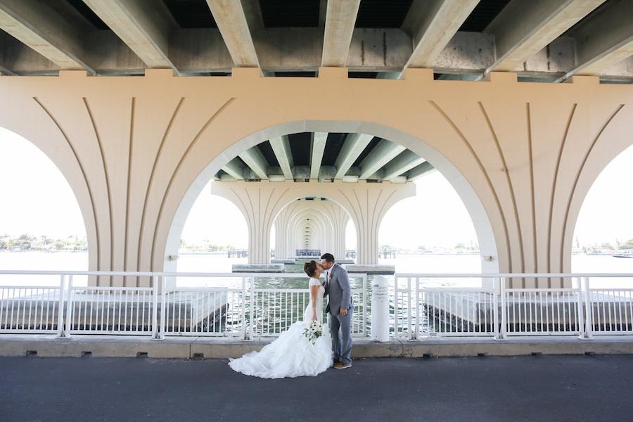 Outdoor Industrial Waterside Wedding Portrait with Dramatic Mermaid Wedding Dress | Waterfront St. Pete Wedding
