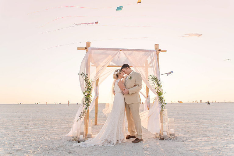 Beach Wedding Ceremony Portrait With Kites Bamboo Arch Drapery And Natural Inspired
