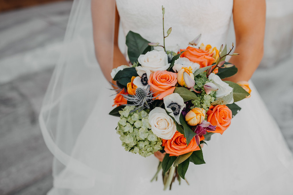Tropical Bridal Wedding Bouquet with Orange and White Roses, Anemones, and Greenery