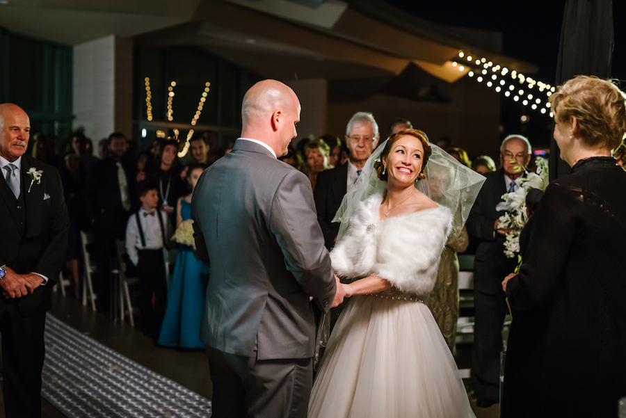 Great Gatsby Roaring 20s Outdoor Nighttime Wedding Ceremony Portrait with Blush Ballgown Wedding Dress and Vintage Inspired White Fur Cape