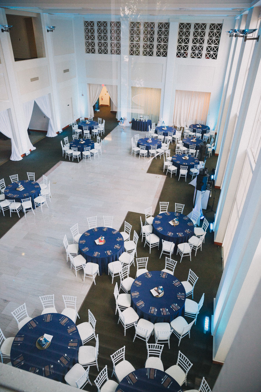 Modern Wedding Reception with White Chiavari Chairs and Blue Linen at Downtown Tampa Wedding Venue The Vault