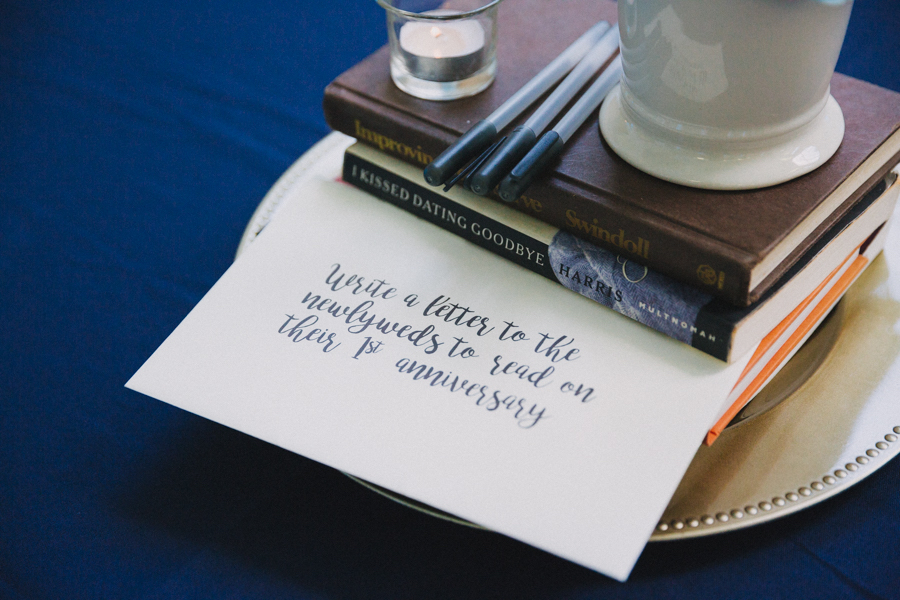 Modern Blue Wedding Reception Creative Table Marker Centerpiece with Books, Guestbook and Pens, and Handwritten Note