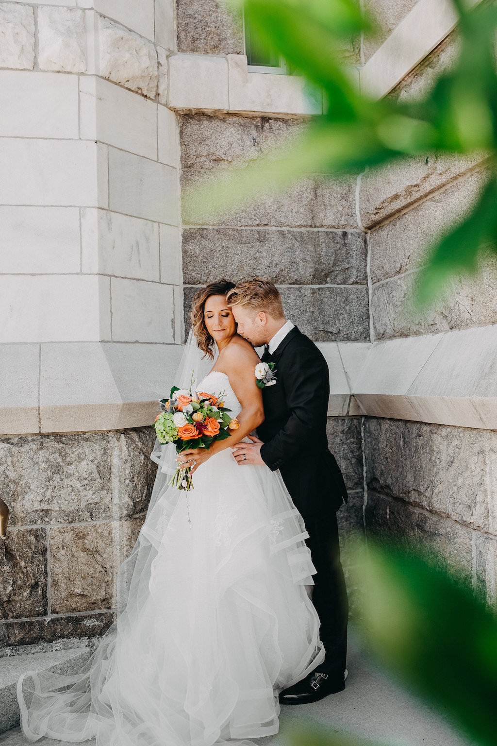Outdoor Church Wedding Ceremony Exit Portrait with Tropical Orange and Greenery Bridal Bouquet   Tampa Florida Wedding Photographer Rad Red Creative