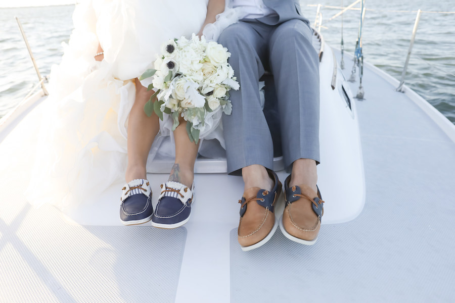 Outdoor Wedding Portrait with Bride and Groom in Boat Shoes on a Yacht with Ivory and Anemone Bouquet | Tampa Bay Wedding Venue Isla del Sol Yacht & Country Club