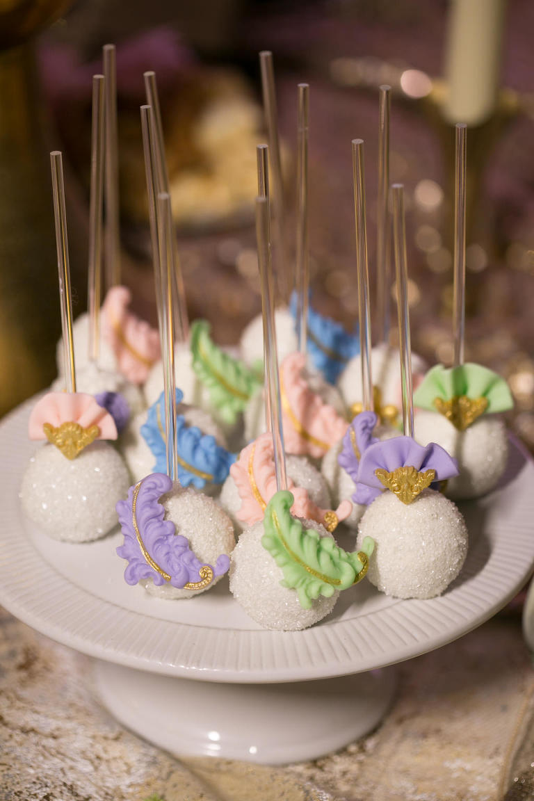 Modern Elegant Tropical Floral Inspired Purple, Pink, Green and Gold Fan and Feather Cake Pops by Tampa Bay Wedding Bakery Sweetly Dipped Confections