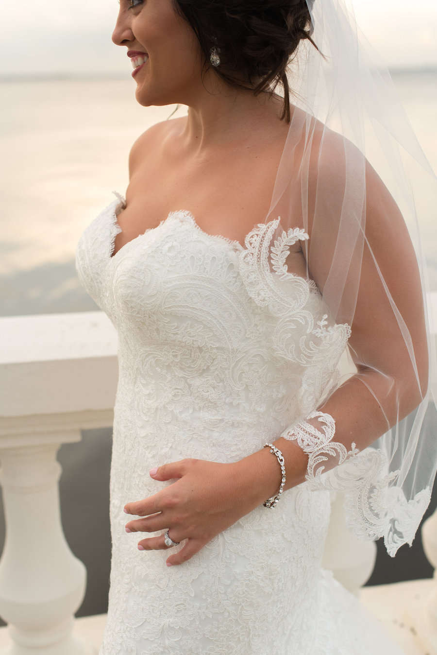Waterfront Bridal Portrait with V Neck Sweetheart Lace Allure Wedding Dress and Lace Edged Veil   South Tampa Wedding Photographer Caroline & Evan Photography