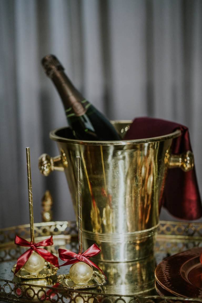 Gold Vintage Cocktail Hour Bar Cart and Champagne Station with Gold Cake Pop Favors | Tampa Bay Vintage Wedding Rentals Ever After Vintage Weddings | Wedding Dessert Bakery Pop Goes The Party