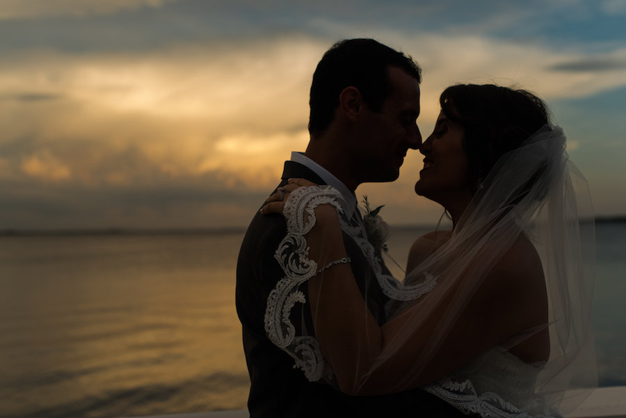 Waterfront Sunset Florida Wedding Portrait with Lace Edged Veil by Tampa Bay Photographer Caroline & Evan Photography