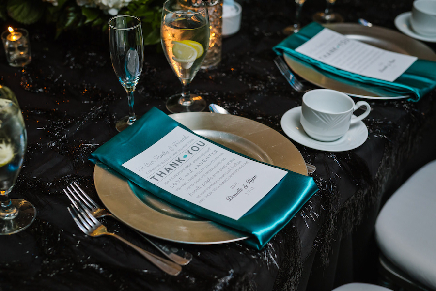 Great Gatsby Themed Wedding Reception Table Decor with Oasis Teal Napkins, Black Beaded Linen and Silver Chargers