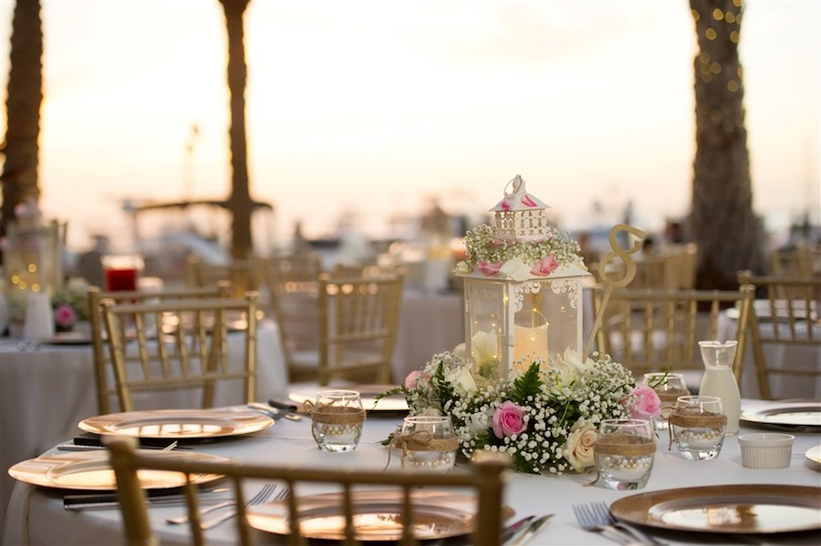 Waterfront Outdoor Wedding Reception Table Decor with Gold Chargers and Chiavari Chairs, Beachy Glass Votives, Baby's Breath and White and Pink Roses and Fern Centerpiece and Lanterns   Tampa Bay Wedding Venue Westshore Yacht Club