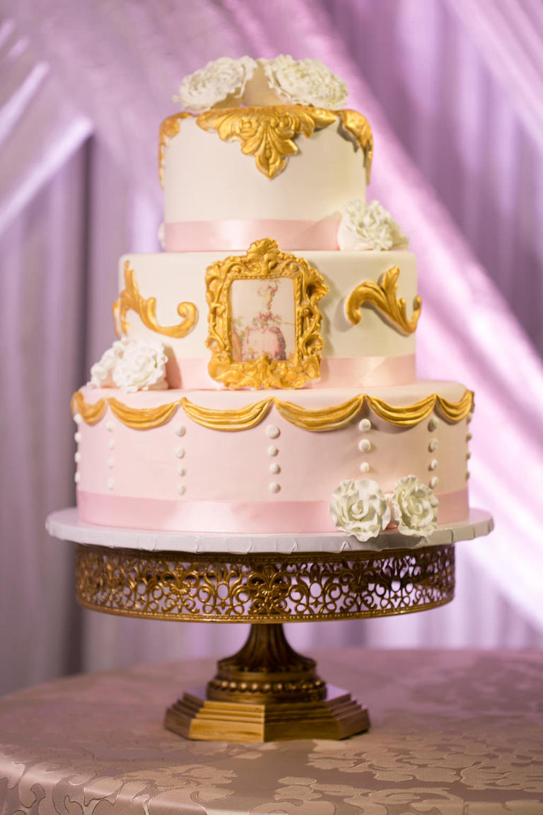Three Tiered Round Wedding Cake with White Floral and Gold Gilded Picture Frame and Pink Ribbon Decor on Antique Gold Cake Stand | Tampa Bay Wedding Bakery A Piece of Cake
