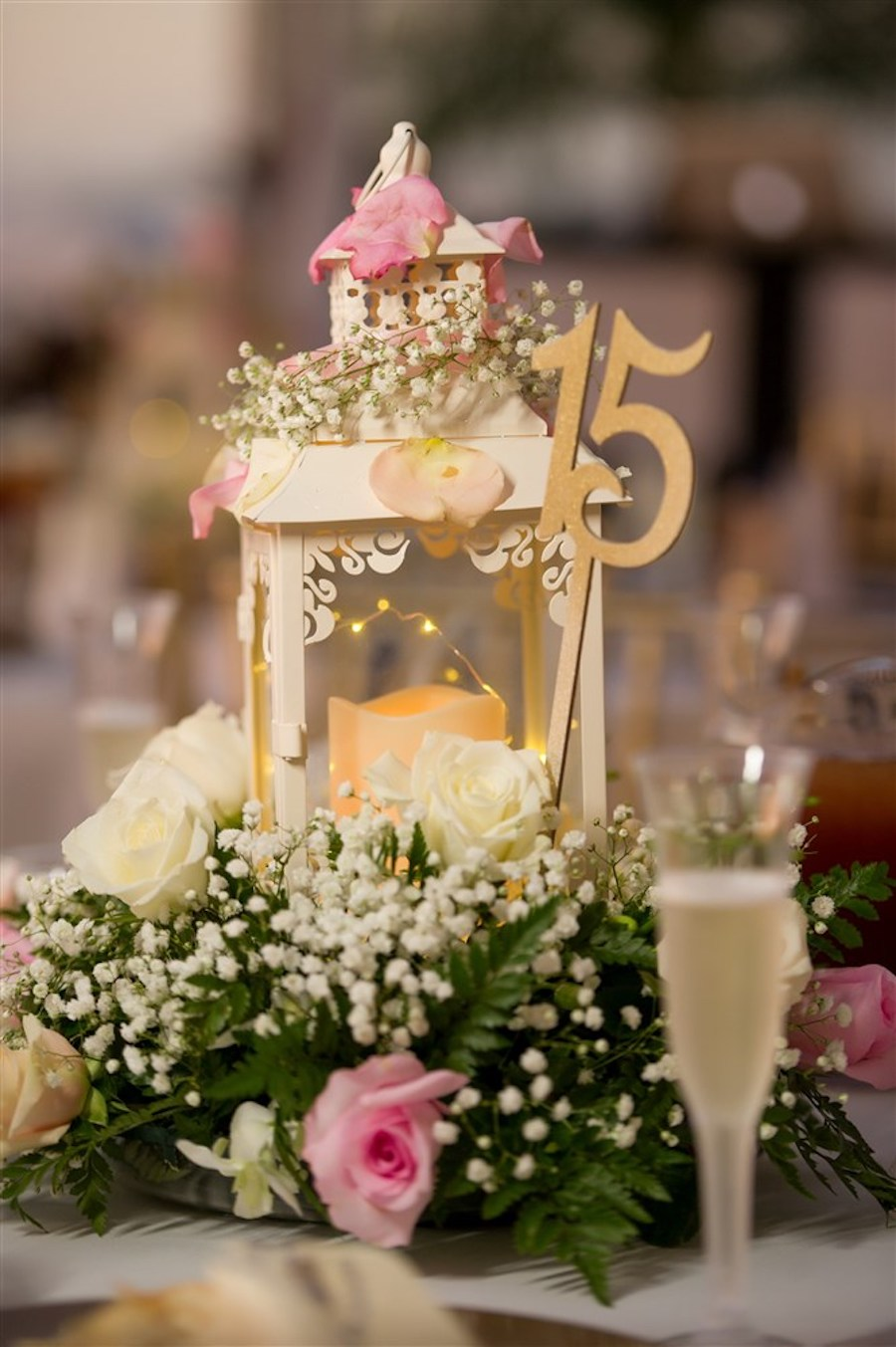 White and Pink Rose with Baby's Breath and Green Fern Centerpiece with Vintage Candle and Gold Numbered Table Marker   Tampa Bay Wedding Reception Decor
