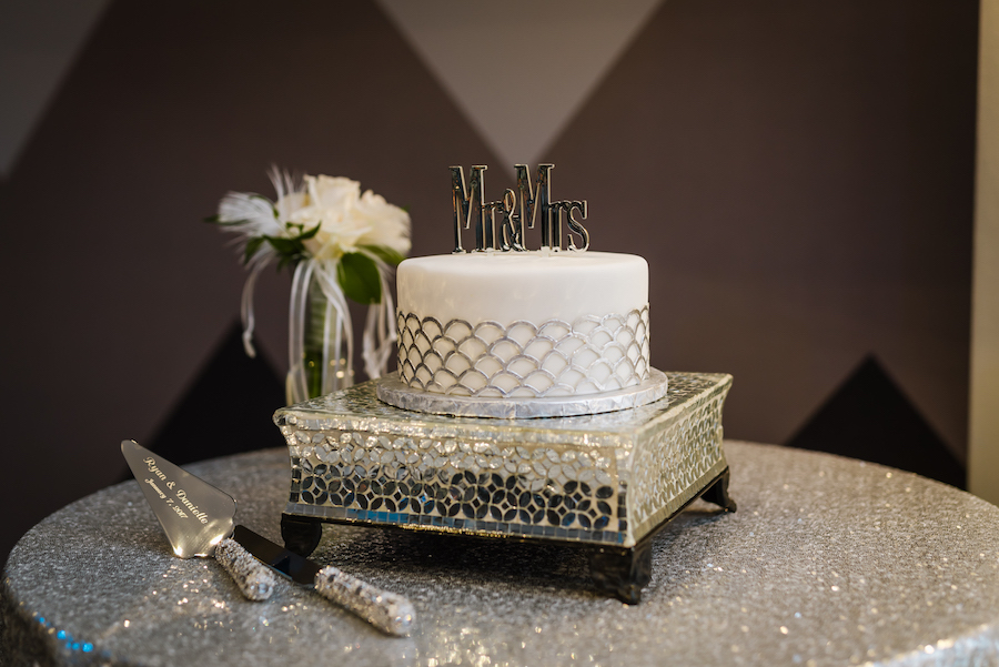 Single Tier Round White Wedding Cake with Silver Scales on Silver Cake Tray and Mr and Mrs Cake Topper