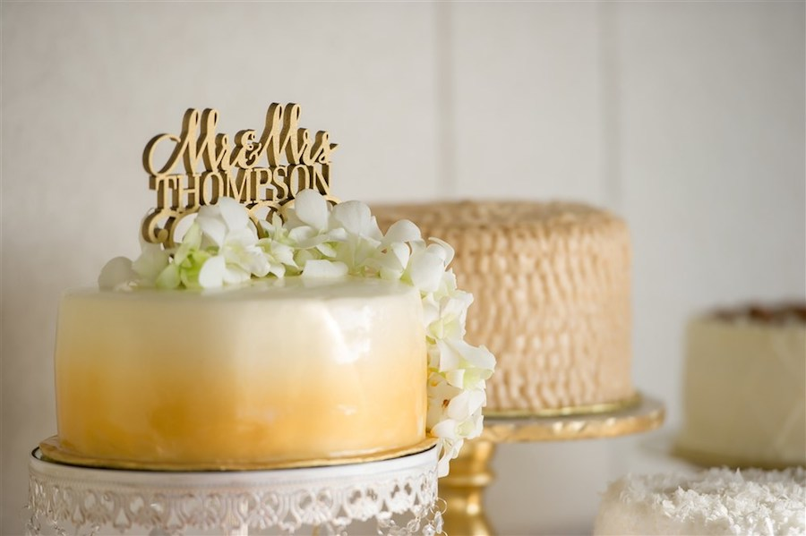 Single Tier Round White to Gold Ombre Wedding Cake topped with Flowers and Gold Mr and Mrs Topper