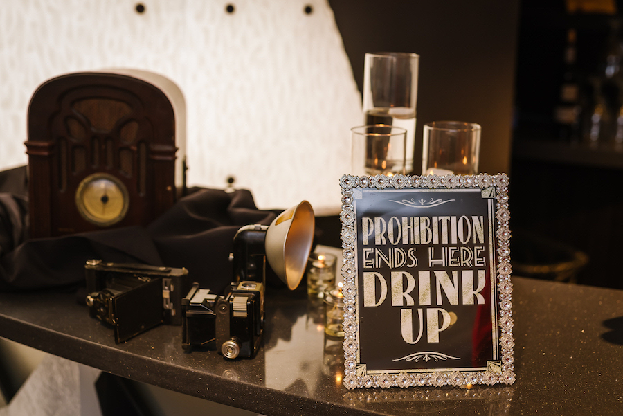 Roaring 20s Black and Silver Wedding Decor with Prohibition Ends Here Bar Sign, Vintage Cameras and Radio