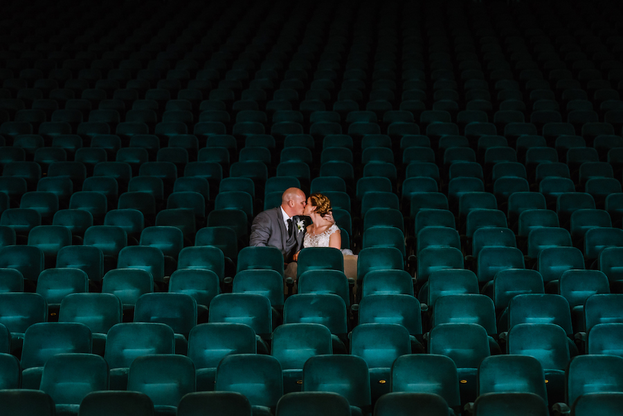 Bride and Groom Nighttime Wedding Portrait in Empty Theater at Tampa Bay Wedding Venue Ruth Eckerd Hall