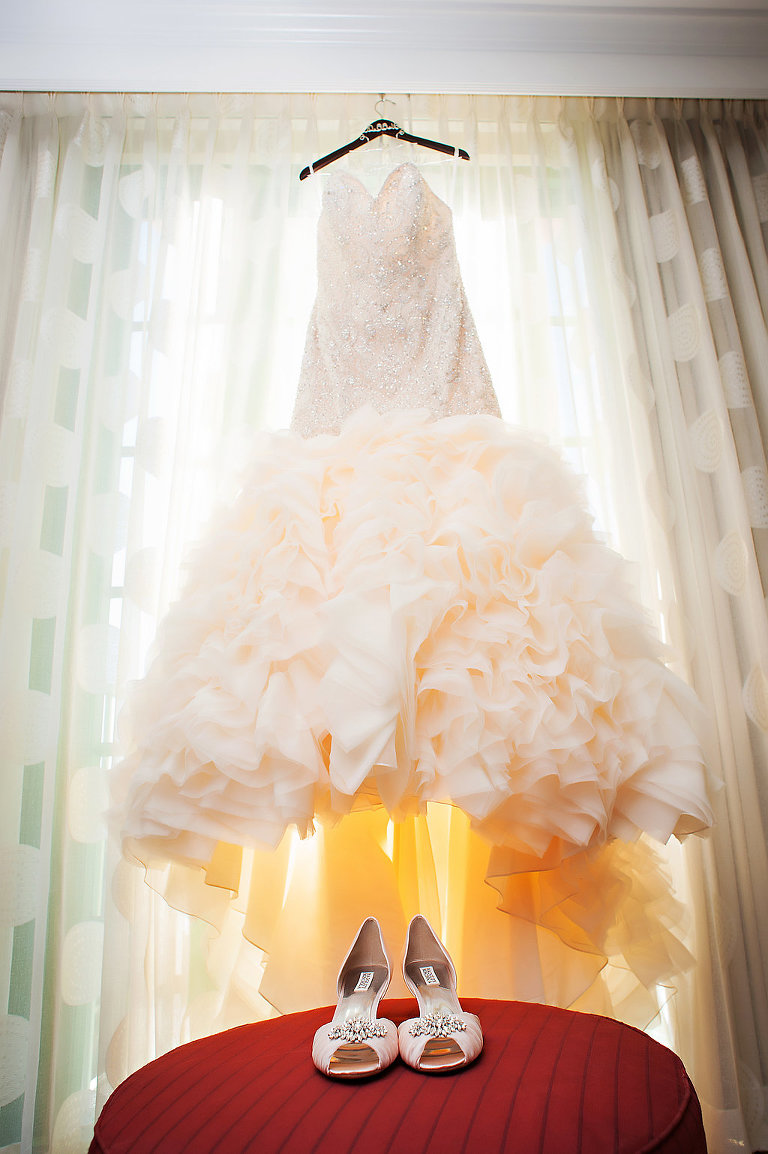 Blush Pink Mermaid Wedding Dress on hanger with Blush Pink Jeweled Peep Toe Wedding Shoes