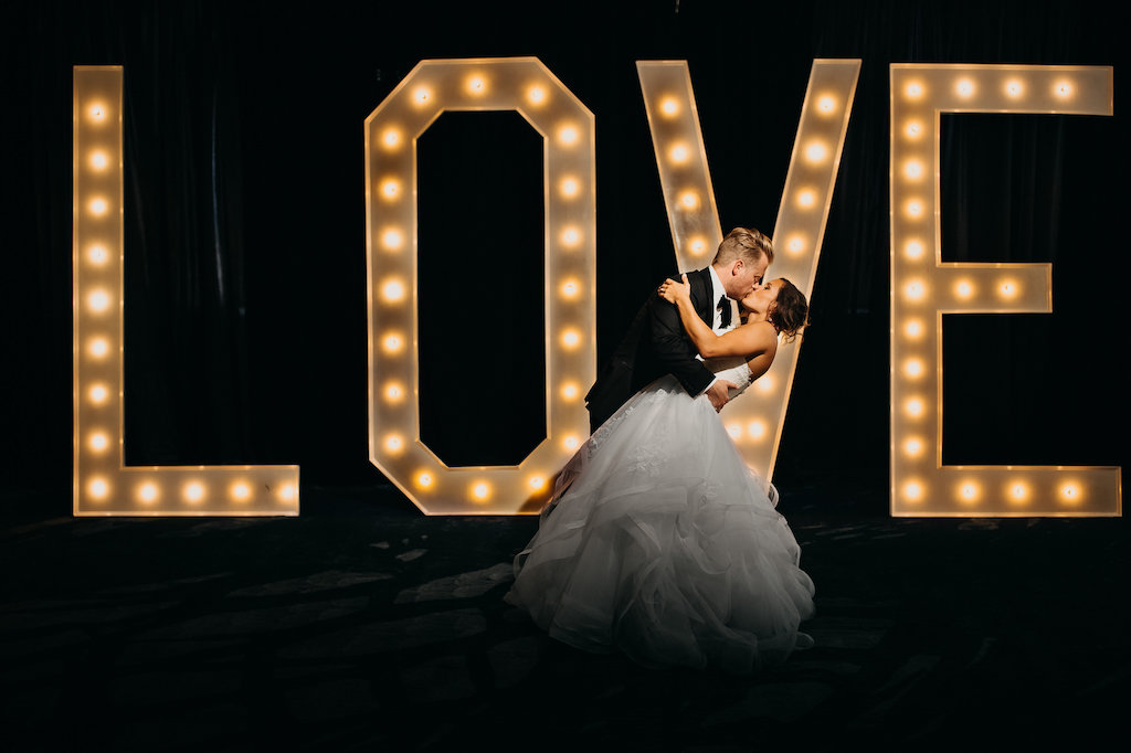 Nightime Bride and Groom Wedding Portrait in front of Love Sign by Tampa Bay Wedding Photographer Rad Red Creative