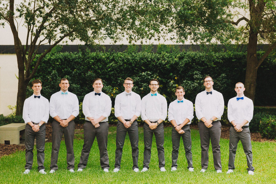 Outdoor Garden Groomsmen Wedding Portrait with White Shirts, Gray Pants, and Blue and Gray Bowties