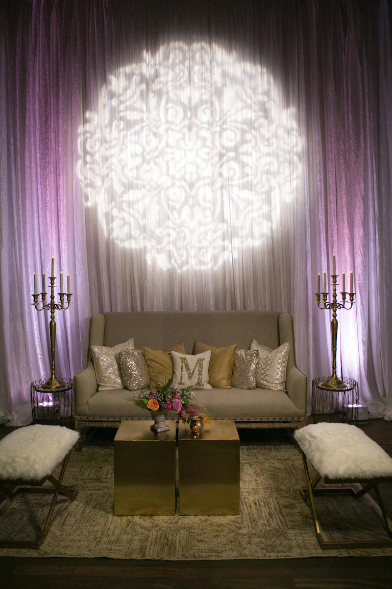 Stylish Wedding Lounge Decor with Modern Furnishings, Tropical Florals, and Purple Uplighting | St. Petersburg Wedding Venue NOVA 535 | Planner UNIQUE Weddings and Events