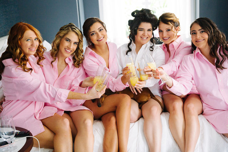 Bridal Party Getting Ready Portrait with Matching Pink Nightshirts and Mimosas