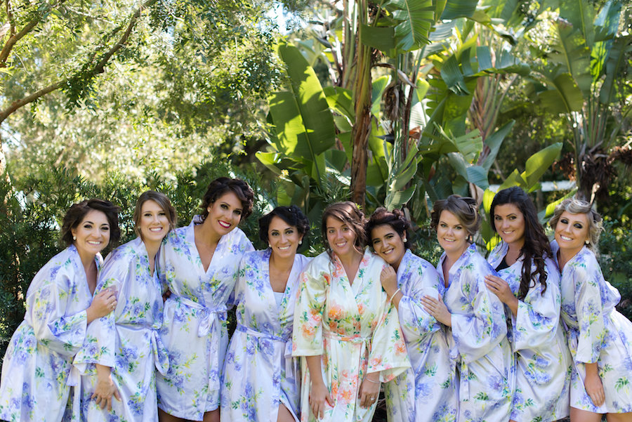 Outdoor Garden Bridal Party Getting Ready Portrait with Bridesmaids in Matching Floral Silk Robes