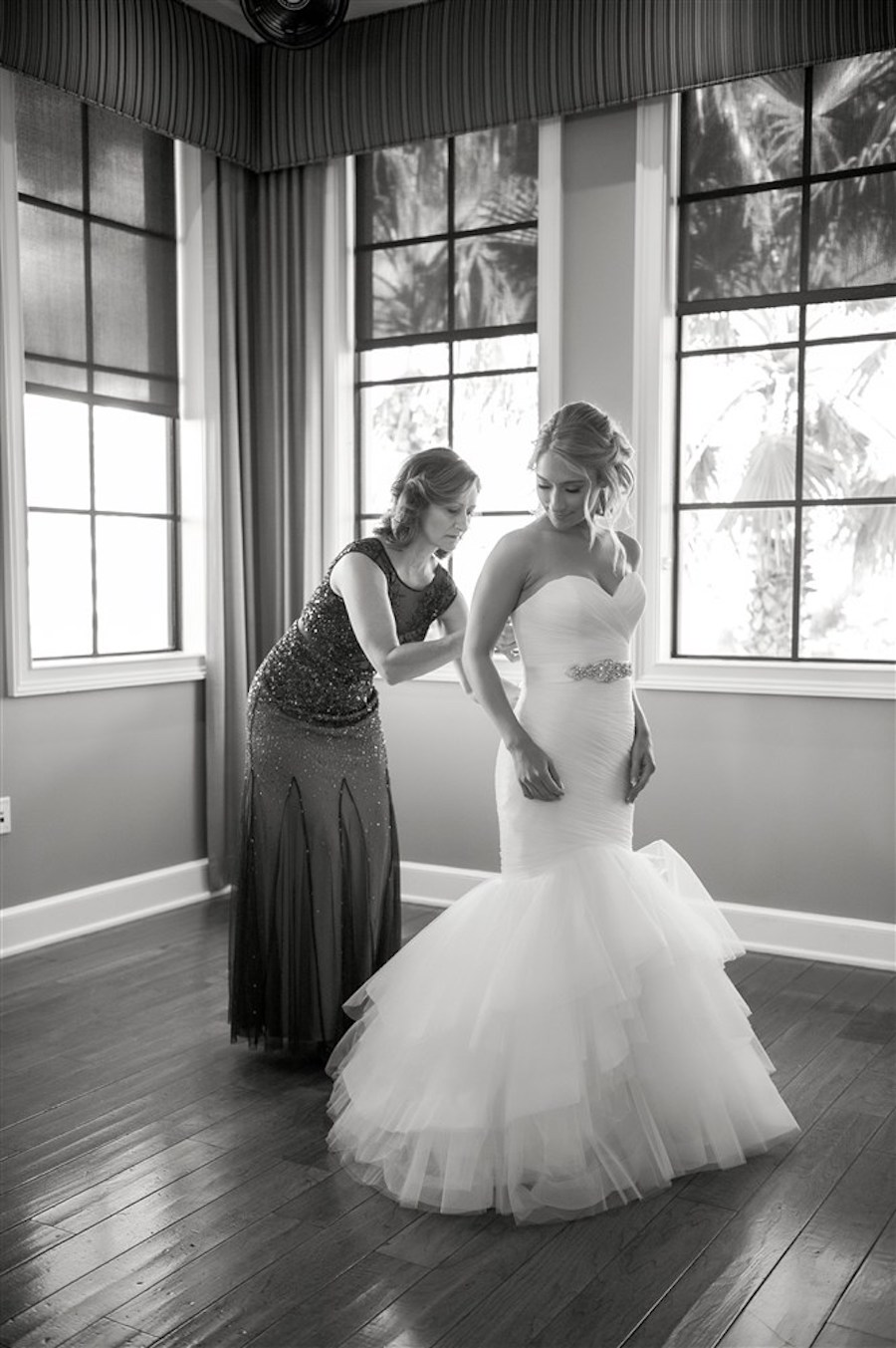 Bride Getting Dressed Portrait wearing Silver Jewel Belted Sweetheart Mermaid Wedding Dress