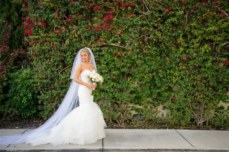 Outdoor Garden Bridal Portrait with Ivory Bouquet with Greenery wearing Sweetheart Mermaid Wedding Dress with Long Veil   Tampa Wedding Photographer Andi Diamond Photography