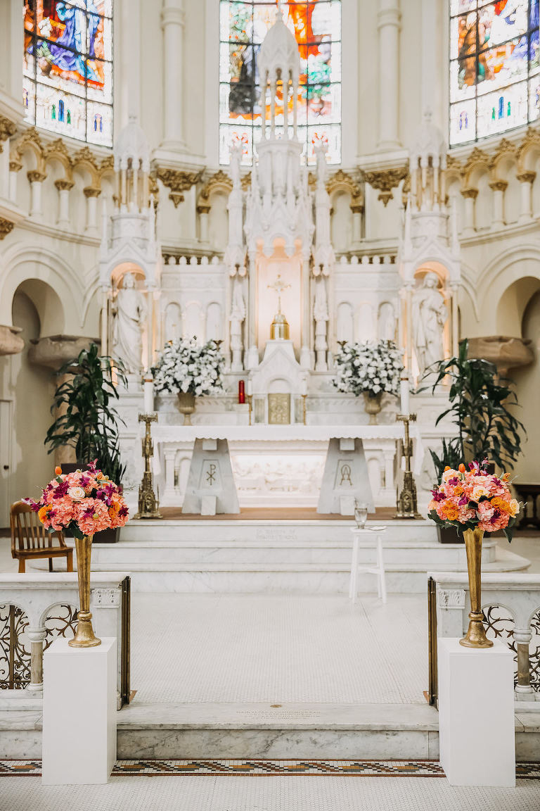 Traditional Church Wedding Ceremony with Tall Tropical Bright Peach and Pink Flowers in Gold Vases | Tampa Ceremony Venue Sacred Heart Catholic Church
