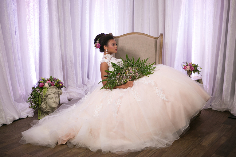 Bridal Portrait with Tropical Fan Style Wedding Bouquet and Creative Statue Decor | High Neck Lace Ballgown Wedding Dress from Tampa Bay Wedding Boutique Truly Forever Bridal | Planner UNIQUE Weddings and Events