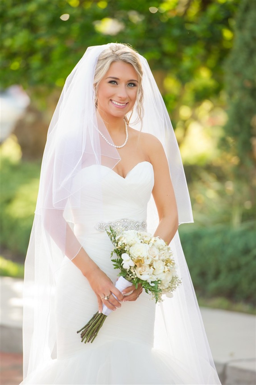 Outdoor Garden Bridal Portrait with Long-Stemmed Ivory Bouquet with Greenery wearing Sweetheart Mermaid Wedding Dress, Pearls, and Long Veil   Tampa Wedding Photographer Andi Diamond Photography