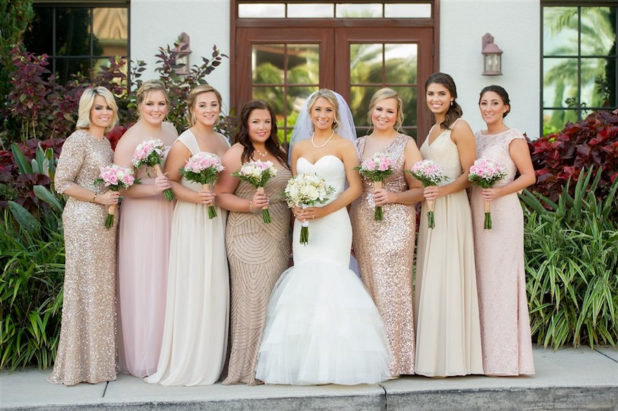 Outdoor Garden Bridal Party Portrait with Long-Stemmed Ivory and Pink Bouquet with Greenery wearing Sweetheart Mermaid Wedding Dress, with Mismatched Gold, Cream, and Blush Elegant Glam Long Bridesmaids Dresses   Tampa Wedding Photographer Andi Diamond Photography