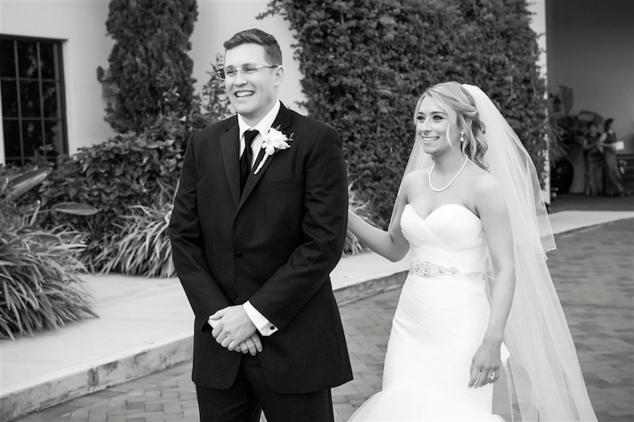 First Look Outdoor Garden Wedding Portrait with White Sweetheart Dress with Silver Jeweled Belt and White Rosebud Boutonnière   Tampa Wedding Photographer Andi Diamond Photography
